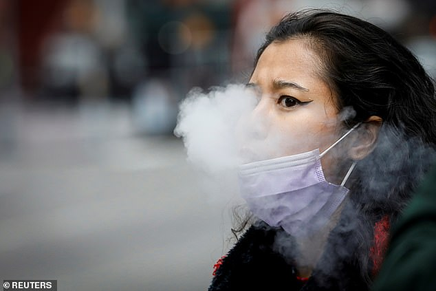 Only 39 per cent of smokers in Britain believe vaping is less harmful than smoking (file image)