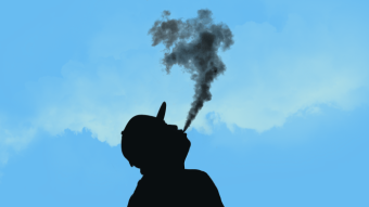 The silhouette of a man vaping.